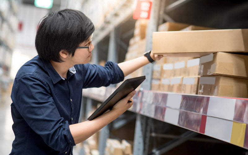 Asian man doing stocktaking of product in warehouse by using digital tablet - SIPMM