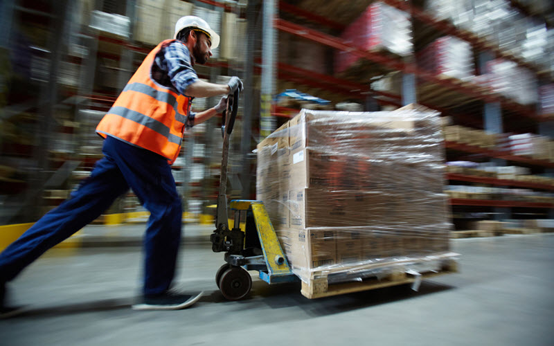 Man pushing cargo on forklift - SIPMM