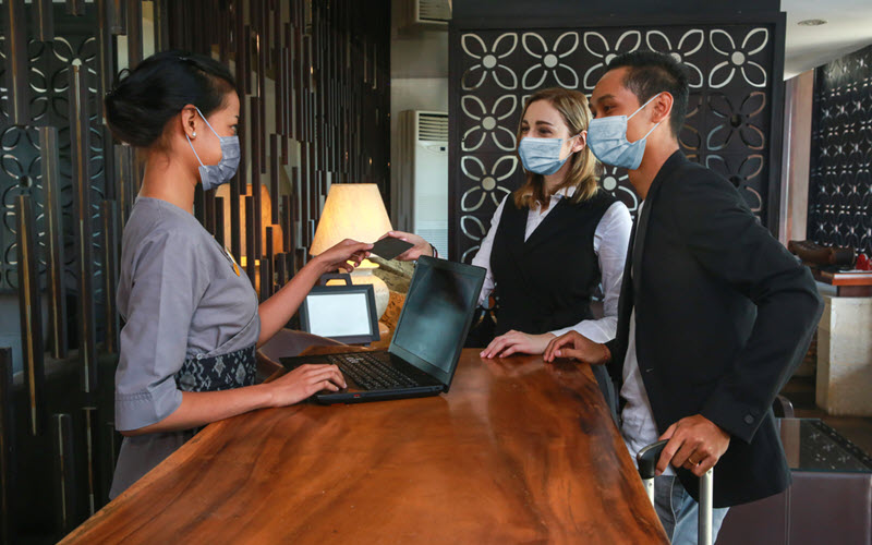 Hotel Reception with protective mask